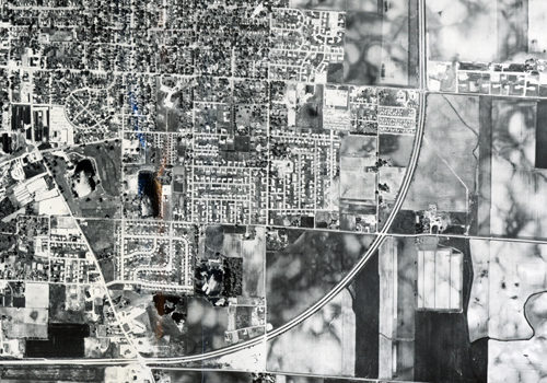 """Aerial view, 1964, of the """"one-hundred miles-an-hour curve."""""""